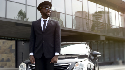 personal driver waiting for arrival of boss at airport