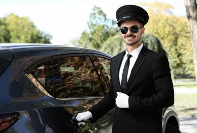young driver opening luxury car door