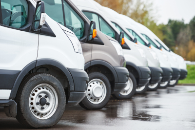transporting services company vans in a row